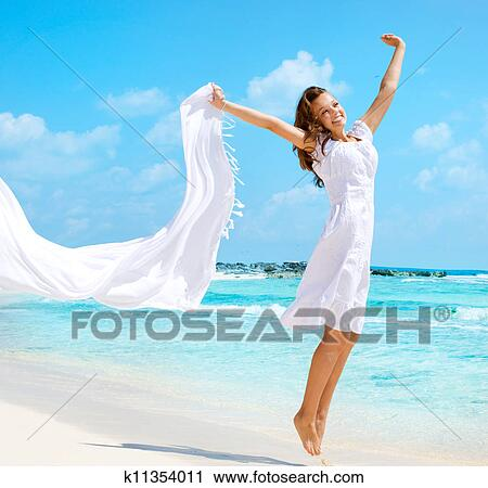 beautiful-girl-with-white-scarf-jumping-