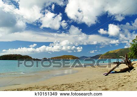 Cinnamon Beach On The Island Of St John In Us Virgin Islands Is Tranquil And Offers White Sandy Beaches Under A Cloud Filled Sky