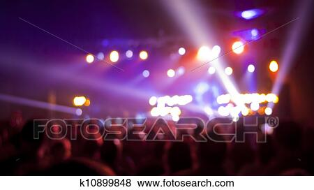 Concert Audience Out Of Focus With Stage Lights And Colors