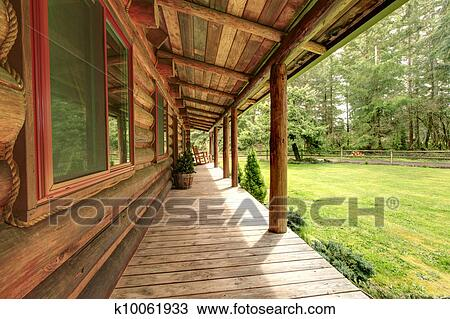 Front Porch Of The Old Rustic Log Cabin