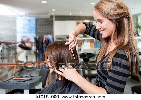 Stock Photography Of Hairdresser Cutting Clients Hair K10181000