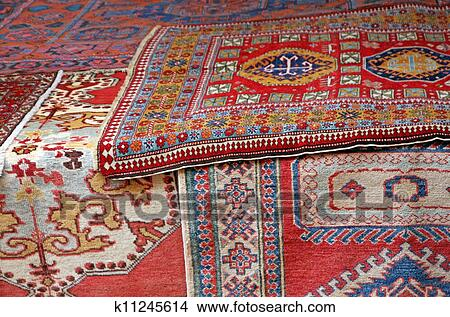 Heaps of valuable oriental carpets and Afghan carpets for sale at the market