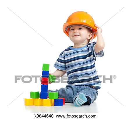 7af972d0416 Stock Photography of kid playing with building blocks toy k9844640 ...