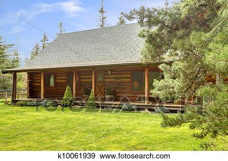 Stock Photograph Of Rustic Log Cabin Front Porch Exterior K10061939