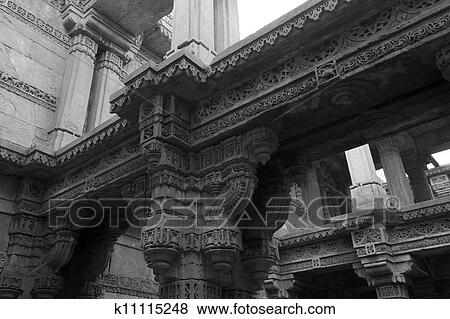 Stone wall and pillar carvings on the adalaj vav monument stock