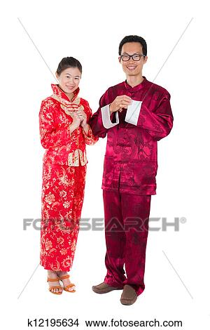 Stock photo of asian couple celebrating chinese new year in asian couple celebrating chinese new year in traditional clothes and greeting m4hsunfo