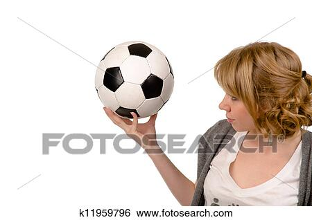 f5a731fe5 Attractive young blonde woman holding up a black and white soccer ball or  football in her hand isolated on white with copyspace