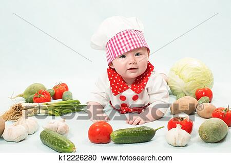 73dff835dd0 Stock Photography of Baby girl wearing a chef hat with vegetables ...