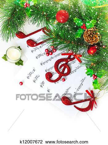 Stock photo of christmas musical border k12007672 search stock christmastime song green fir tree decoration traditional xmas carol music sound new year greeting card christmas eve celebration m4hsunfo