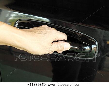 Car door handle hand Human Hand Is Going To Pull Cars Door Handle Fotosearch Stock Photography Of Hand Is Going To Pull Cars Door Handle