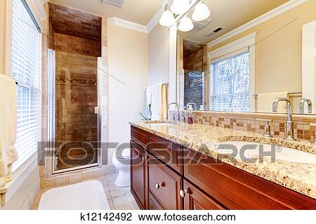 Large Bathroom With Cherry Cabinets And Granite Countertop Stock Image K12142492 Fotosearch