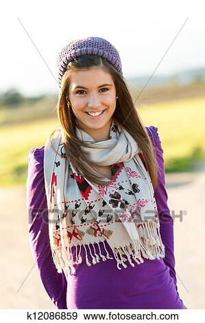 Close Up Portrait Of Cute Teen Girl With Scarf And Beanie Outdoors
