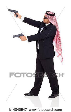 Arabic Hitman Holding Guns Stock Photo K14040647 Fotosearch