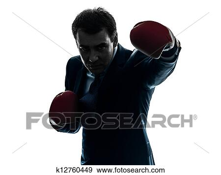 stock photograph of business man boxer with boxing gloves silhouette