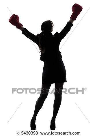 pictures of business woman boxing gloves silhouette k13430398