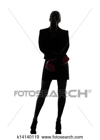 stock photograph of business woman boxing gloves silhouette