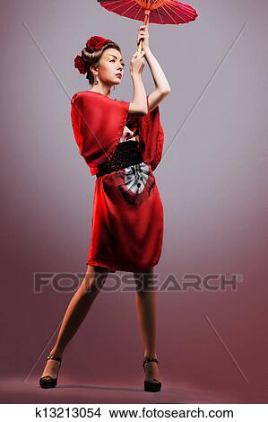 9713c7d9c529d Fashion asian woman wearing traditional japanese red kimono with umbrella
