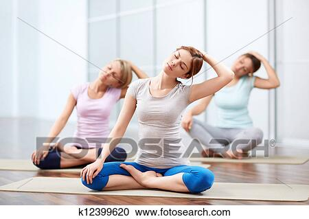 group yoga sessions stock image  k12399620  fotosearch