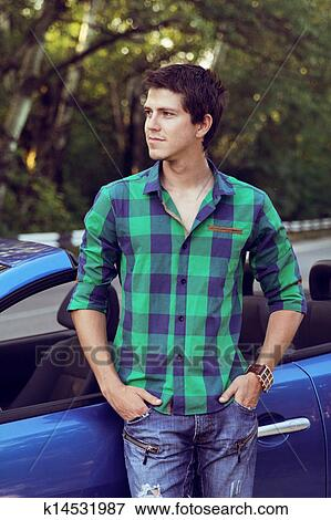 Handsome Man With Casual Clothes Posing Near His Car Outdoors Portrait