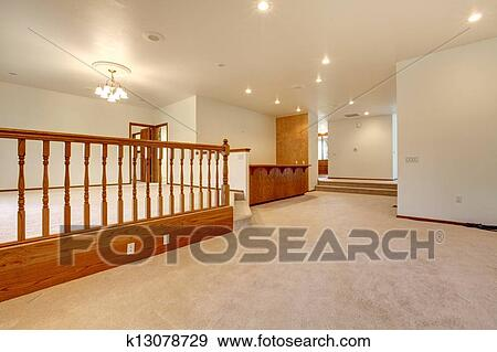 Large Empty Room With Beige Carpet And