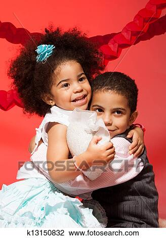 stock photo of loving siblings hugging k13150832 search stock