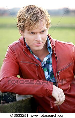 Stock Photography Of Male Fashion Model Posing Outdoors K13533251
