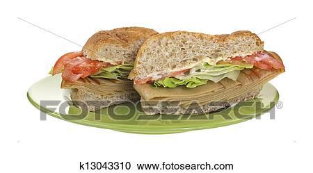 Stock Photography Of Tofu Turkey Sandwich On Green Plate K13043310