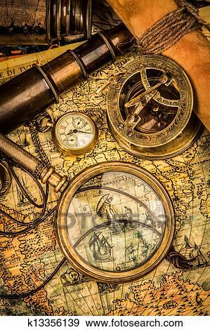 Stock photograph of vintage magnifying glass lies on an ancient stock photograph vintage magnifying glass lies on an ancient world map fotosearch search gumiabroncs Gallery