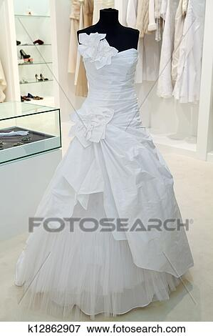 a3c13c479 Stock Photo - Wedding dress on a mannequin in a bridal shop. Fotosearch
