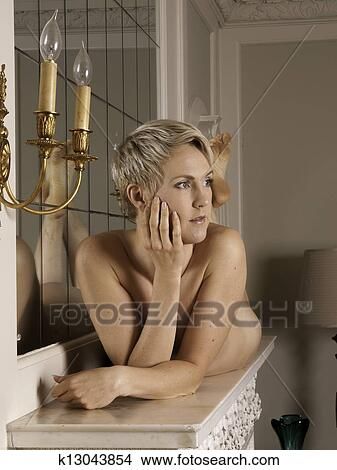 Naked Woman Laying On The Mantelpiece