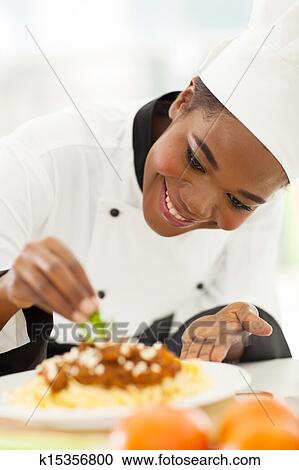 African American Chef Decorating Pasta Dish Stock Image K15356800 Fotosearch