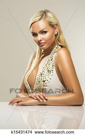 Blond busty mature woman