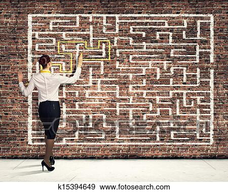 Businesswoman solving maze problem Stock Illustration