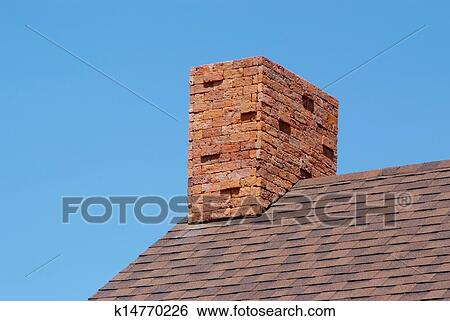 Close Up Brick Chimney On The Roof And Blue Sky