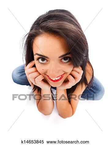 Cute Girl From Wide Angle Smiling Cutely Holding Her Head In Hands