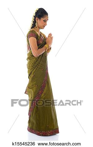ba0ed78e75 Stock Photograph - traditional indian female giving greetings during diwali.  Fotosearch