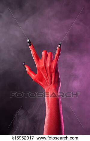picture of heavy metal gesture red devil hand with black nails