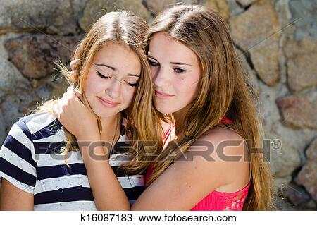 photo hugging comforting crying woman