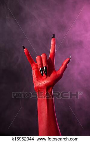 stock photo of rock sign red devil hand with black nails k15952044