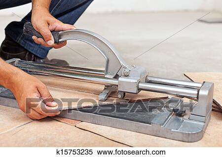 Stock Image Of Worker Cutting Floor Tiles With Manual Cutter