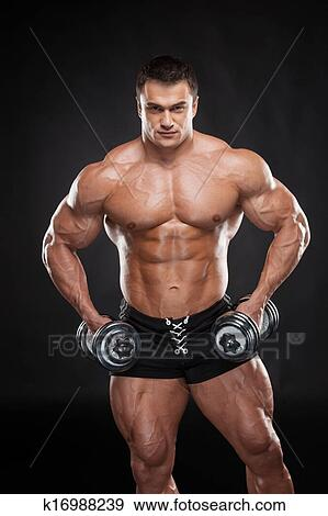Stock Photograph of Sexy muscular bodybuilder lifting dumbbell ...