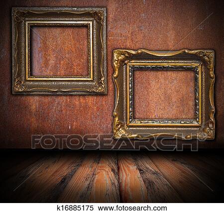 Vide Peinture Cadres Sur Rouillé Mur Banques De Photographies