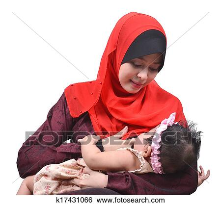 stock images of young asian muslim mother breastfeeding her cute