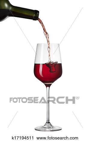 stock photography of red wine pouring into glass with splash