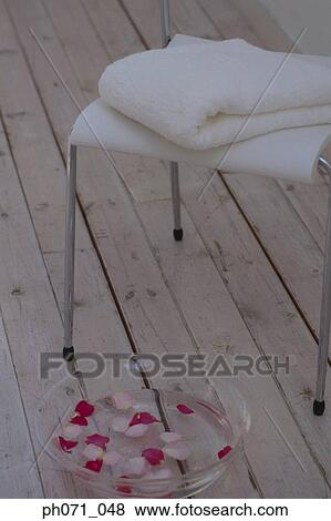Fantastic Bowl Of Rose Petals And Folded White Towel On Chair Stock Ibusinesslaw Wood Chair Design Ideas Ibusinesslaworg