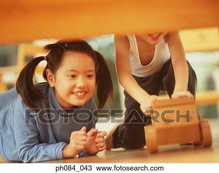 Sister And Brother Playing Wooden Toy Car