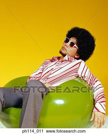 stock photography of young asian male with afro hair in sitting on
