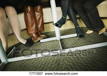Picture of Womens legs under table 1771507 Search Stock