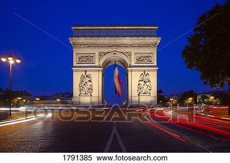 stock image of arc de triomphe on the champs Élysées at night