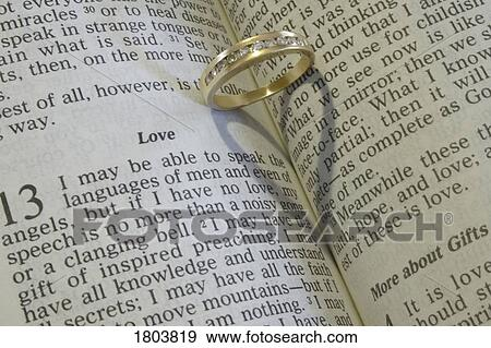 stock photograph of a wedding ring on an open bible 1803819 search